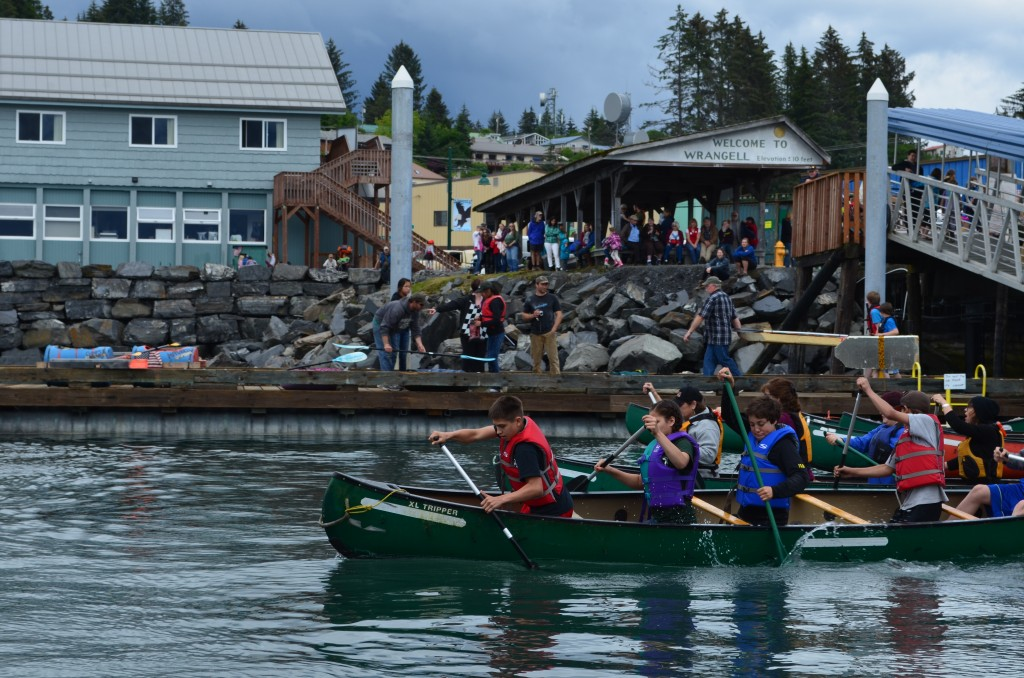 "Paddlers fit as many people as they could into a canoe to compete in the ""War Canoe"" race Wednesday, July 2, 2014."