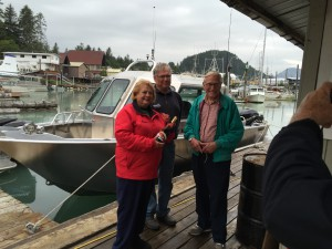 Nancy Murkowski, Dave Swenson and Frank Roppel before christening the Rainbow. (Aaron Bolton, KSTK News)
