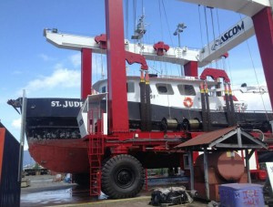 Wrangell's new Ascom boat lift hauls the 98-foot fish-packer St. Jude out of the water Saturday, May 24. (Delton Claggett /KSTK)