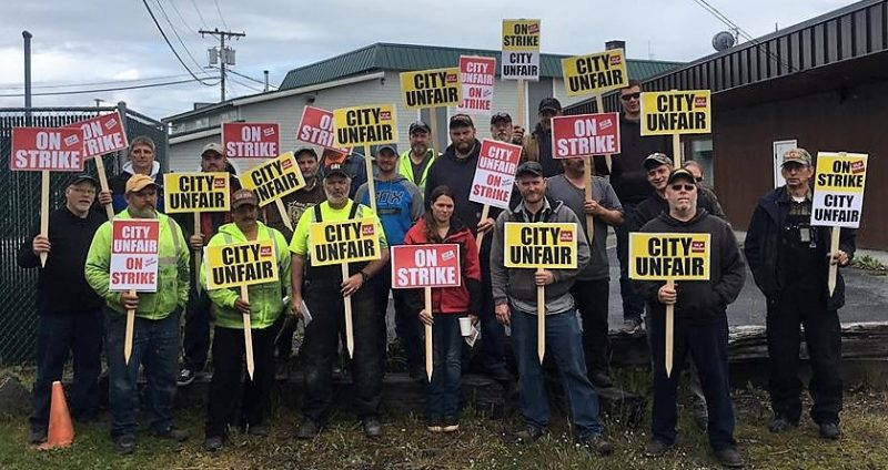 Wrangell municipal employyes represented by the International Brotherhood of Electrical Workers pose on the picket line June 22, 2017. (Photo courtesy IBEW )